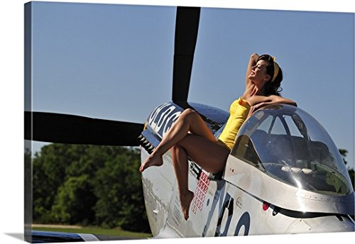 Christian Kieffer Gallery-Wrapped Canvas entitled Retro pin-up girl sitting outside the cockpit of a P-51 Mustang by greatBIGcanvas