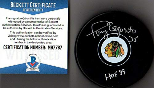 (Autographed Tony Esposito Hockey Puck - Beckett bas Hof 88 7767 - Beckett Authentication - Autographed NHL Pucks )