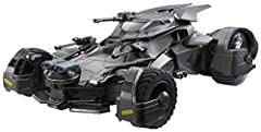 """New from the Justice League movie comes this 20"""" by 12"""" scale, highly detailed Batmobile for the adult collector! The updated, iconic Batman vehicle features true-to-movie design, weaponry and armored wheels with metal axles. Open the driver'..."""