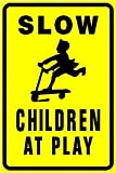 SLOW CHILDREN AT PLAY warn street park sign