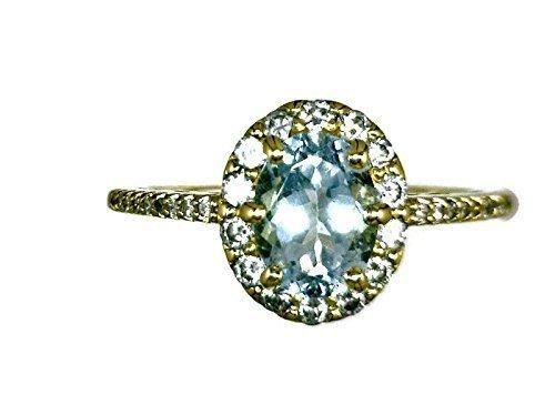 18 K Yellow Gold Aquamarine Halo Ring Oval Stone 0.69 CT and Diamonds 0.46 CT