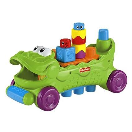 Mattel T Fisher Price Cocodrilo musical con ruedas y piezas de apilar