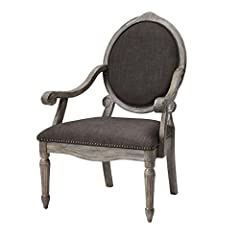 Discover sophistication in a modernized update to this traditional, yet classic design of this Brentwood chair. The wonderful mix of a graphite linen look combined with a reclaimed Grey finish and pops of nail head give this chair definite mo...