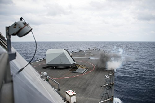 Home Comforts The littoral combat ship USS Freedom (LCS 1) fires its 57-mm gun during a surface gunnery exercise. by Home Comforts