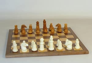 Staunton Tagua Nut Chessmen on a Maple/Walnut Chess Board