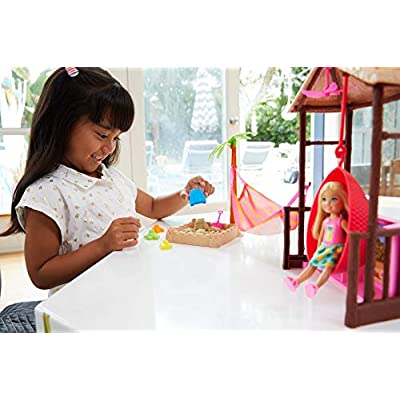 Barbie Chelsea Doll and Tiki Hut Playset with 6-Inch Blonde Doll, Hut with Swing, Hammock, Moldable Sand, 4 Molds and 4 Storytelling Pieces, Gift for 3 to 7 Year Olds​​​: Toys & Games
