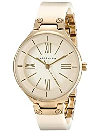 Anne Klein Women's AK/1958IVGB Gold-Tone and Ivory Resin Bangle Watch