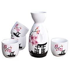 "Tosnail 5 pcs Japanese Sake SetSet includes 1 sake bottle and 4 cups, packed in box.Dimension: bottle is 5"" tall by 1.8"" dia.; cup is 1.8"" tall by 1.8"" dia.Material: ceramic; Color: Pink BlossomMicrowave and dishwasher safe.A great gift idea ..."