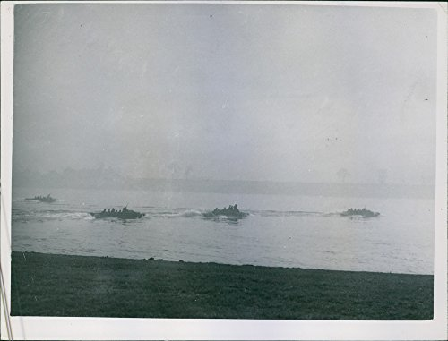 Vintage photo of Assault craft packed with the soldiers of the Ninth U.S. Army head for the eastern bank of the Rhino River during the mass crossing of the River.
