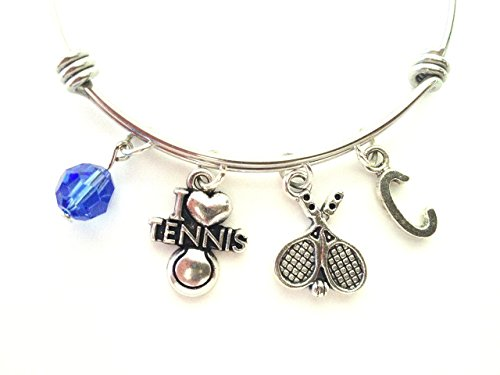 Tennis themed personalized bangle bracelet. Antique silver charms and a genuine Swarovski birthstone colored element.