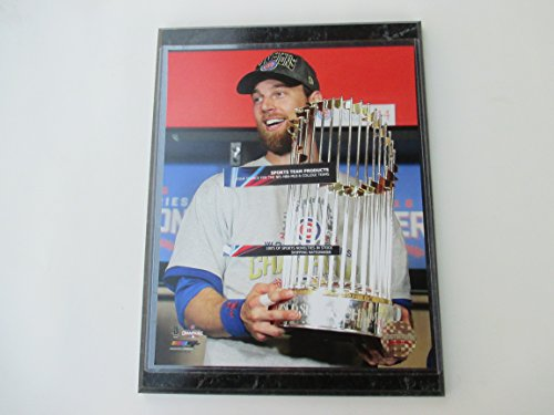 (World Series MVP BEN ZOBRIST holds the Championship Trophy)