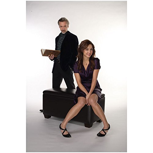 Erin Leather (Being Erica Erin Karpluk as Erica Sitting on Leather Ottoman and Michael Riley as Dr. Tom Holding Book 8 x 10 inch photo)