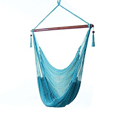 "Sunnydaze Hanging Rope Hammock Chair Swing - Caribbean Style Extra Large Hanging Chair for Backyard & Patio - Sky Blue - LARGE & SPACIOUS SIZE: There's no need to worry about fitting into this big hanging chair. With an overall measurement of 47"" W x 36"" D x 48"" H and a 40"" W seat, this outdoor hammock chair will support any adult or child that weighs less than 300 pounds. COMFORTABLE DESIGN FOR RELAXATION: Unwind from the stress of a long day in ultimate comfort with this cozy hammock swing. Made of soft polyester, which is superior and longer-lasting than cotton, this hanging chair hammock will provide you many years of top-quality performance. MULTIPLE HANGING OPTIONS: The durable loop-end top of this sitting hammock allows you to hang it anywhere securely. All you need is a beam, branch, stand, or sturdy structure to hang the outdoor rope hammock chair from. - patio-furniture, patio, hammocks - 419D7ugsKBL. SS400  -"