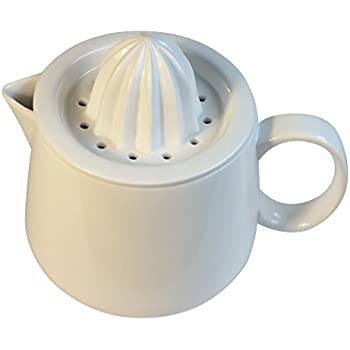 Manual citrus juicer reamer strainer with white ceramic pitcher. Enjoy fresh juice!