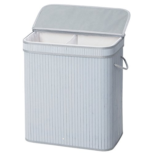 White, laundry hamper with two compartments.