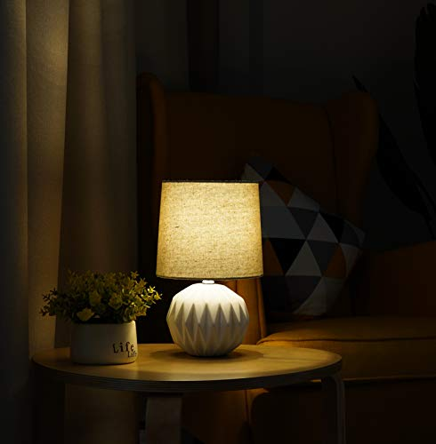 """Tayanuc Small Geometric Ceramic Bedside Nightstand Table Lamp, White Textured Desk Lamp Linen Drum Fabric Shade for… - Ceramic Table Lamp: This white ceramic table lamp shaped like a pineapple takes a fresh twist with textural geometric ceramic body. The solid color allows the plentiful texture and modern silhouette to truly shine and adds a hint of glam to nightstand. Excellent gifts for the coming Thanksgiving Day. Materials: The inimitable desk lamp will turn heads with its smooth textured curves balanced on a white ceramic base. It is paired with beige linen drum fabric shade that casts an ambient glow. Dimensions: 7.5"""" D x 12.6"""" H. - lamps, bedroom-decor, bedroom - 419gXHATneL -"""