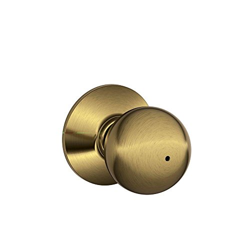 - Schlage F40ORB609 Orbit Privacy Knob, Antique Brass
