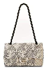 Classic Chanel Double Flap bag rendered in grey and cream printed velvet, featuring a woven chain shoulder strap and muted gold-tone hardware. Chain-link and grosgrain shoulder strap. CC' turn-lock closure on flap. Interior zip pocket, two sl...