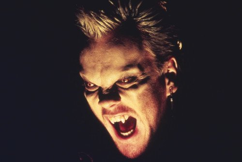 Kiefer Sutherland in The Lost Boys great pose with vampire teeth 24x36 Poster by Silverscreen