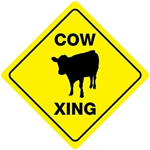 COW crossing sign bright vibrant easy to see yellow save the cows bulls on Farm