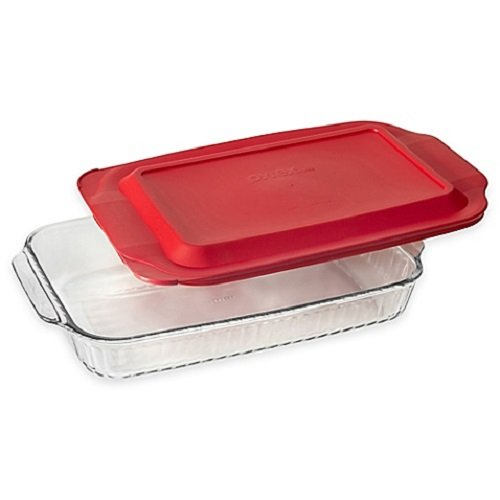 Glass oblong baking dish with red plastic lid.