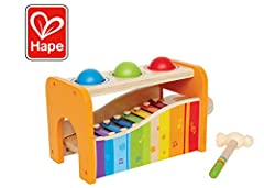 Hape's Pound and Tap Bench with Slide Out Xylophone is a multifunctional musical delight and sound experience for toddlers. Toddlers ages 12 months to 3 years can explore different notes and sounds by letting the balls fall on the keys or sli...