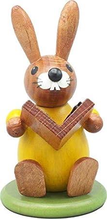 Rudolphs - Cofre del tesoro con forma de conejo de Pascua sobre zócalo, color amarillo, con libro, altura de 9 cm: Amazon.es: Hogar