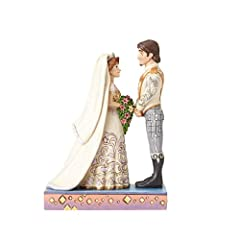 Jim Shore's Royal Wedding collection reimagines Disney's most beloved couples on their big day in his distinctive folk art style. Here, Rapunzel and Flynn prepare to take their vows, sculpted from stone resin and hand-painted in exquisite detail.