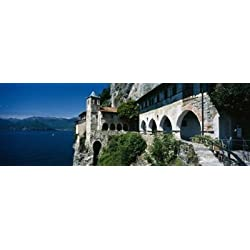 Walkway along a building at a lake Santa Caterina del Sasso Lake Maggiore Piedmont Italy Poster Print (36 x 12)