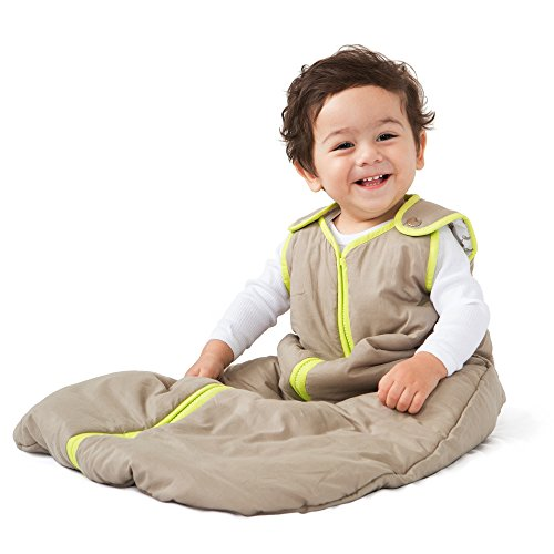 Baby boy wearing a baby sleeping bag.