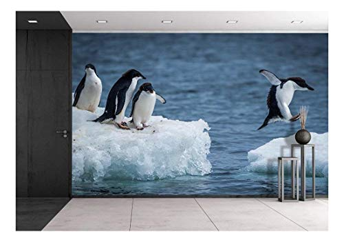 wall26 - Adelie penguin jumping between two ice floes - Removable Wall Mural | Self-adhesive Large Wallpaper - 66x96 - Penguin Ice Floe