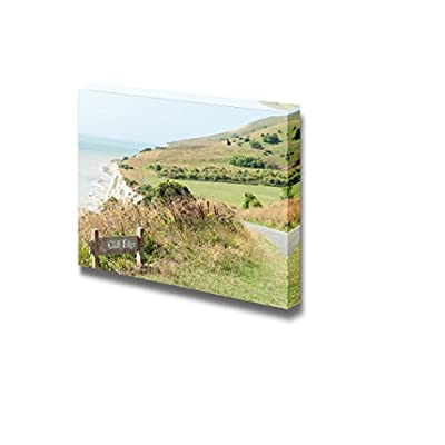 Cliff Edge Danger Sign Amongst Beautiful Scenery on The South Downs Way Hiking Trail Wood Framed - Canvas Art Wall Art - 24