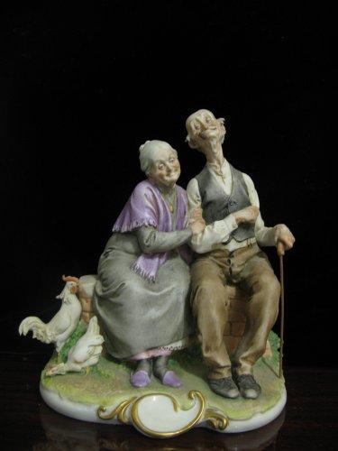 - G. Cappe Vintage Capodimonte Italy Elderly Couple with Chicken Figurine