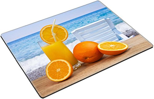 MSD Place Mat Non-Slip Natural Rubber Desk Pads design: 12540334 Glass of orange juice on a beach table
