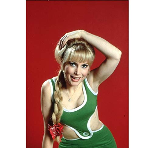 Barbara Eden with arm wrapped over head 8 x 10 Inch ()