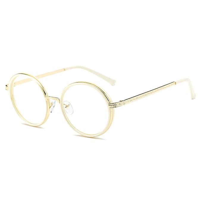 Gafas doradas con lente transparente y patillas decoradas.