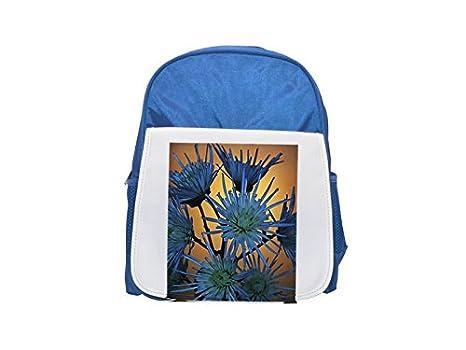 Una triste de flores azules contra un fondo amarillo estampado mochila azul infantil, mochilas lindas