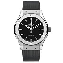 Titanium case with a black rubber strap. Fixed titanium bezel. Black dial with silver-tone skeleton hands and index hour markers. Dial Type: Analog. Date display at the 3 o'clock position. Automatic movement with a 42 hour power reserve. Scra...