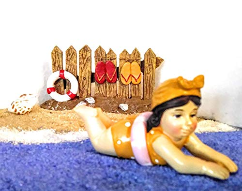 - Yellow-Bathing Beauty Lady Beach/Lake Miniature Fairy Garden Features Fence with Flip Flops, Tan, White and Blue Sand Packs, Shell, TFC Token, and Lady in Yellow Swimsuit