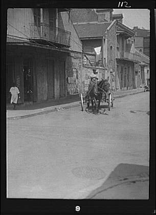 Photo: Street scene,roads,French Quarter,New Orleans,Louisiana,LA,Arnold - In Orleans French Quarter Shopping New