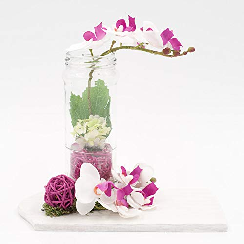 Tischgesteck Mit Lila Pink Weissen Orchideen Im Glas Auf Einem Weissen