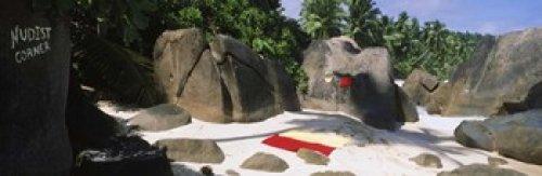 Nudist corner written on a rock on the beach Mahe Island Seychelles Poster Print (18 x 6)