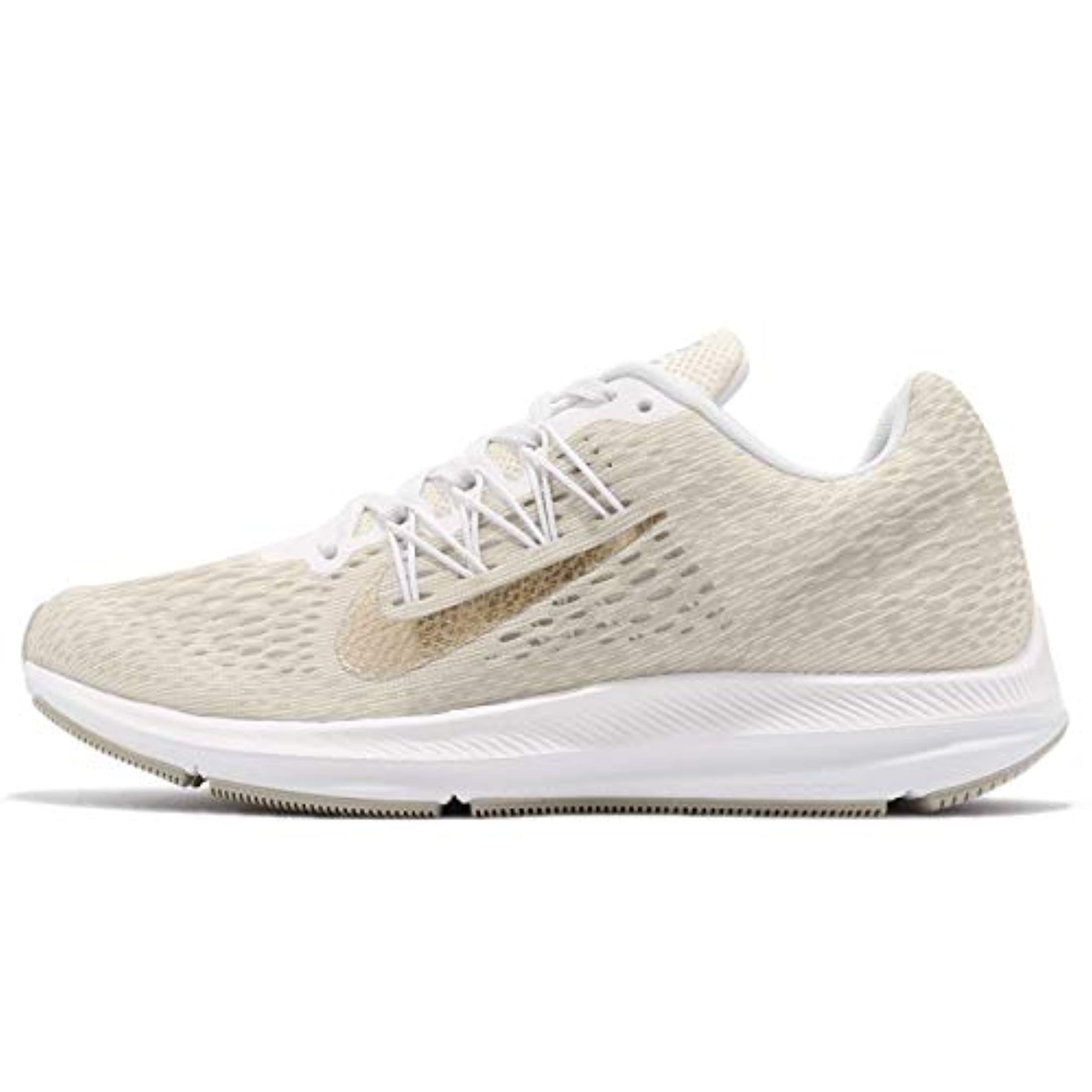 4a01e81ec NIKE Women's Air Zoom Winflo 5 Running Shoe, Phantom/Metallic  Gold-String-White, 8.5