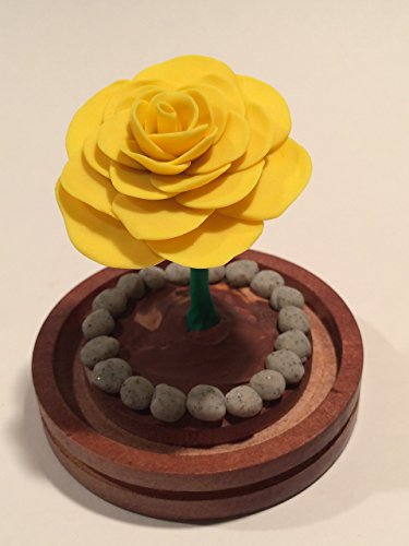 Beauty and the Beast enchanted rose in a glass dome, Bright yellow glow in the dark