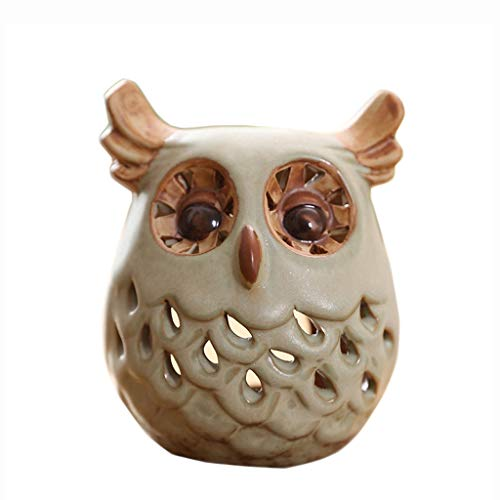 MSchunou The uniquely shaped hollow owl candlestick decoration, cute and stylish, beautiful and practical, the color is simple and stable, easy to match all kinds of furniture and environment, ornamen]()