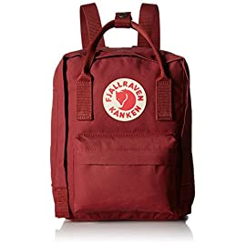 Fjallraven, Kanken Mini Classic Backpack for Everyday 1 ICONIC: Meet the mini version of our classic Kanken. Same design, smaller size. Stash everyday essentials in the main zippered compartment, front zippered pocket, and two open side pockets. PRACTICAL: Meet the material: Vinylon F. It has a weird name but it's dirt-resistant, water-resistant, and wipes clean. FUNCTIONAL: Two-way zipper with rain flap for protection. Long adjustable shoulder straps. Dual top snap handles for quick carry. Reflective logo.