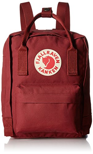 "Fjallraven - Kanken Mini Classic Backpack for Everyday 1 <p>Mini version of Kanken Classic. Long shoulder straps that can be adjusted to fit both small and large backs. Two side pockets and a zippered pocket on the front. Reflective logo. ICONIC: Meet the mini version of our classic Kanken. Same design, smaller size. Stash everyday essentials in the main zippered compartment, front zippered pocket, and two open side pockets. PRACTICAL: Meet the material: Vinylon F. It has a weird name but it's dirt-resistant, water-resistant, and wipes clean. FUNCTIONAL: Two-way zipper with rain flap for protection. Long adjustable shoulder straps for adults and kids. Dual top snap handles for quick carry. Reflective logo. ROOMY: 7 L of storage space for everything you need and some things you don't. Measures 11.4"" (29 cm) x 7.9"" (20 cm) x 5.1"" (13 cm). Weighs 0.5 lb. HERITAGE: Durable, timeless, functional. Since 1960.</p>"