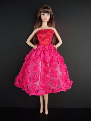 A Hot Pink Knee Length Dress Covered in - Barbie Doll In Pink Dress