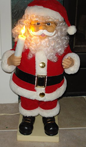 - Santa Claus Animated Plush Holding A Candler That Lights Up and Moves as Santa Moves