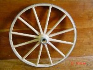 """Amish Country Collectible Handmade 24 Inch X 1 Inch Steam Bent Hickory Wagon Wheel for Home and Garden Decor 24 Inch Amish Country Collectible Hand Crafted Hickory Steam Bent Wooden Wagon Wheel with Steel Tire Rim and Hub. Authentic Wagon Wheel That Can Be Used to Add That Rustic Country or Western Decor to Any Room or Landscape.decorative Steam Bent Hickory Wood Wagon Wheel 24"""" X 1"""""""